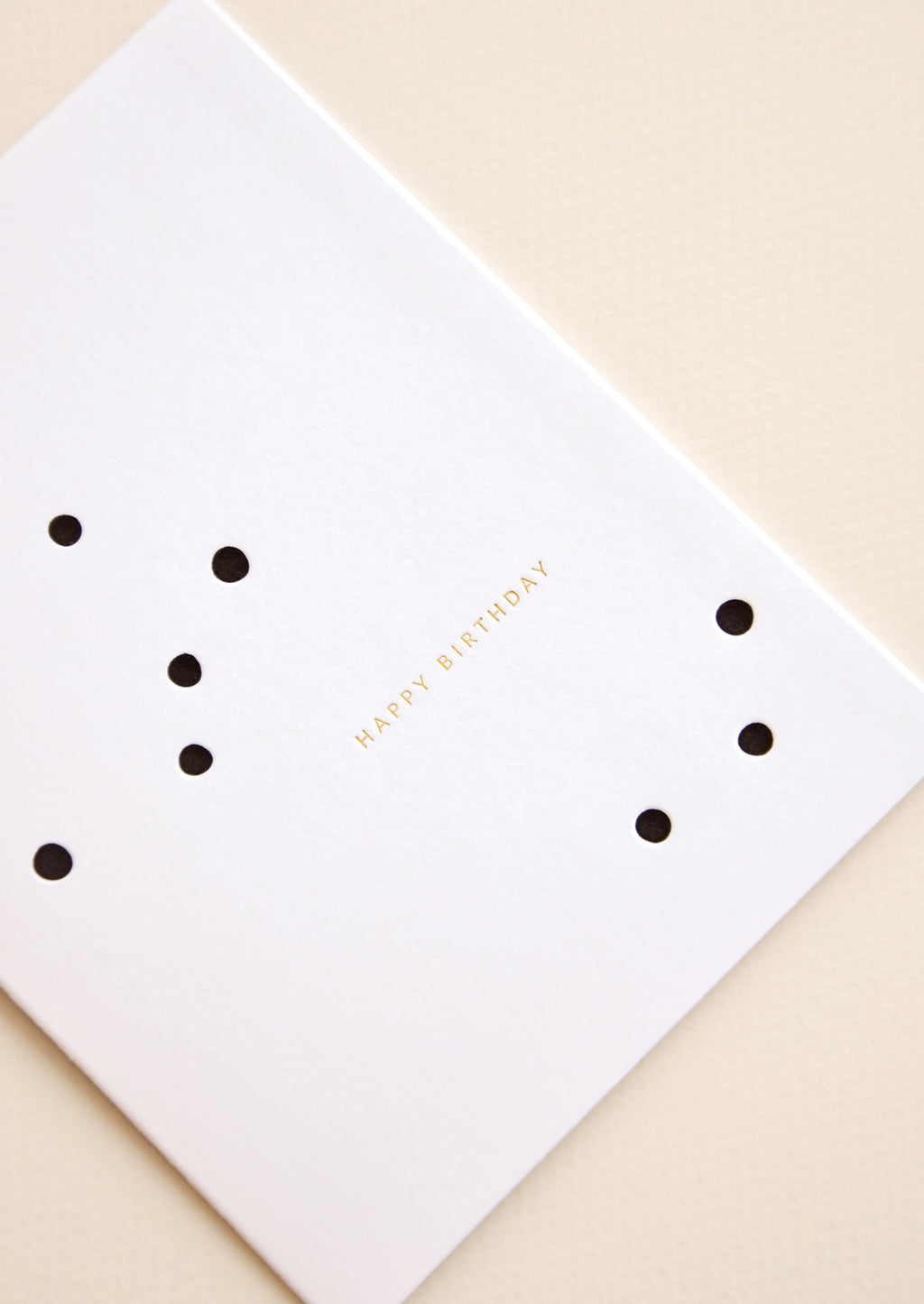 "2: Golden ""happy birthday"" text on dot printed greeting card"