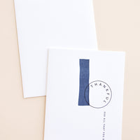 "1: White notecard with black text ""Thankful For All That You Do"" and navy blue painted swatches, with white envelope."