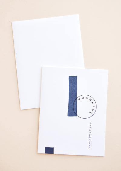 "White notecard with black text ""Thankful For All That You Do"" and navy blue painted swatches, with white envelope."