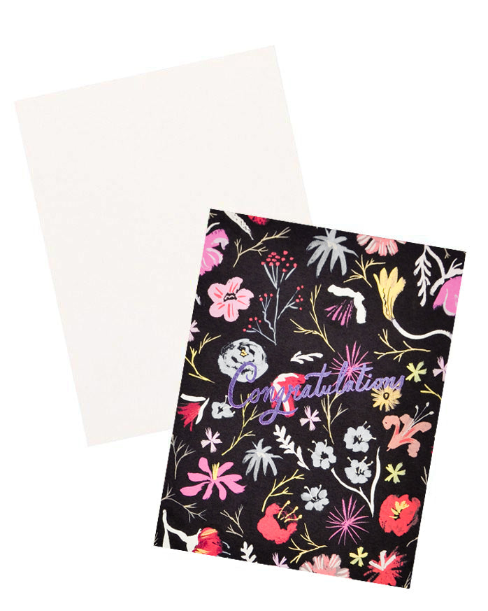 3: Notecard with colorful floral decoration on black background, and the text Congratulations in metallic pink script, with white envelope.