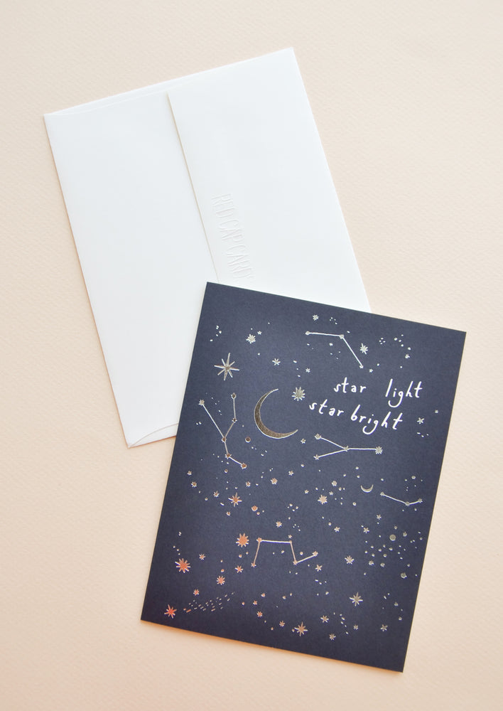 "1: Dark grey notecard with silver foil constellation decoration and the text ""Star Light Star Bright"", with white envelope."
