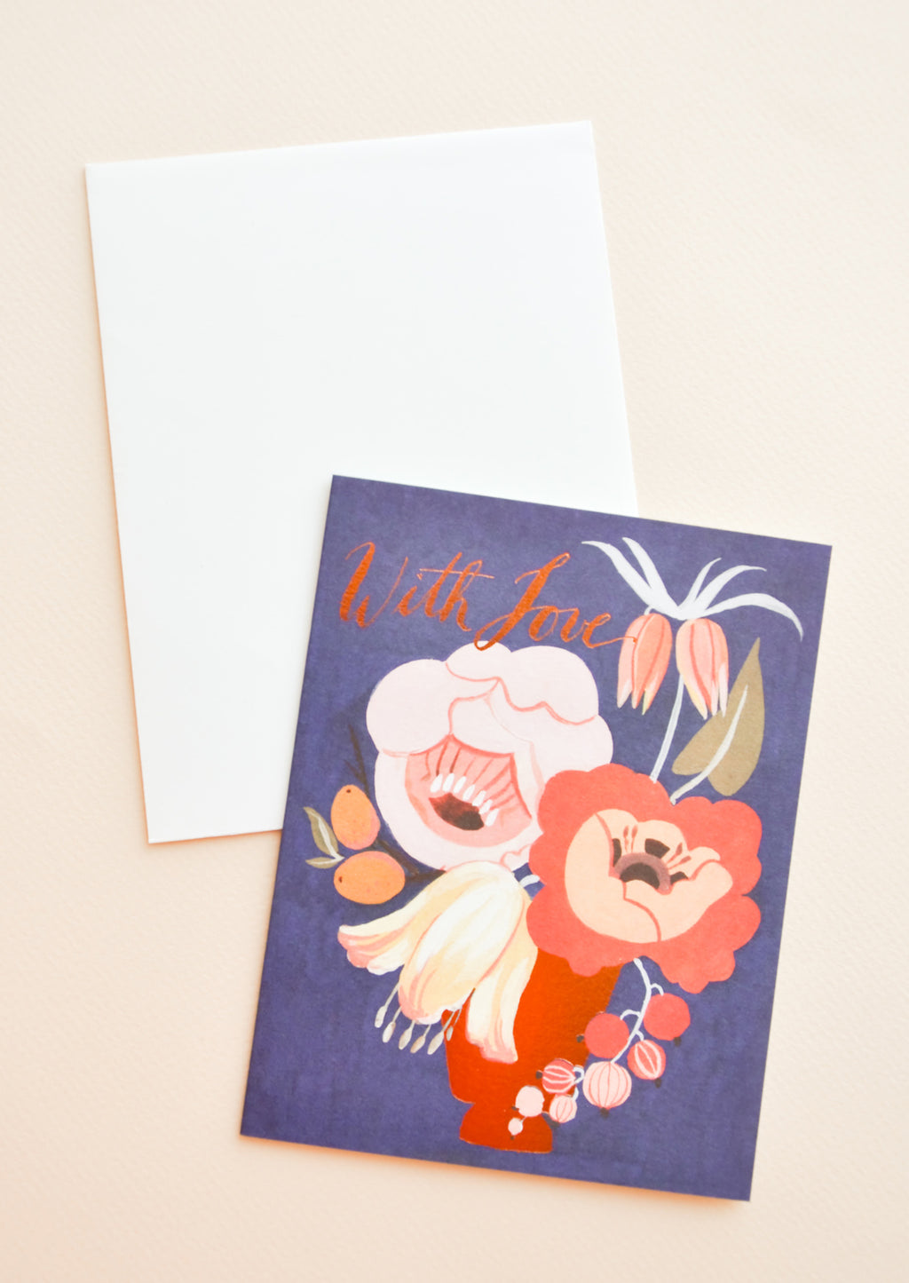 "1: Blue notecard with large colorful floral decoration and the text ""With Love"", with white envelope."