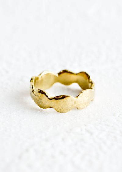 A brass ring in an organic, curvy shape.