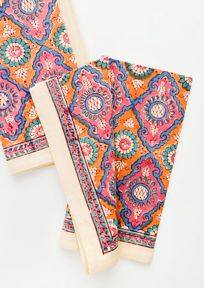 Pair of block printed cotton napkins in vibrant pink and orange pattern