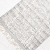 1: Flatweave rug with contrasting oriental pattern and fringe trimmed edges on two sides