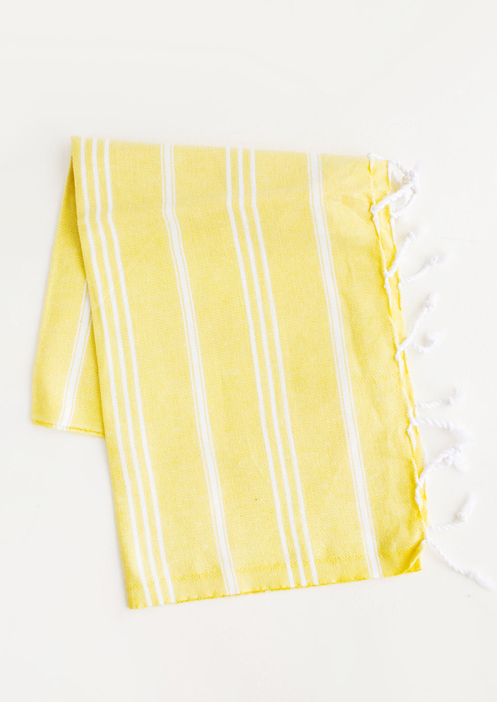 Yellow / Hand Towel: Cotton towel with white stripes in yellow, twisted fringe on ends
