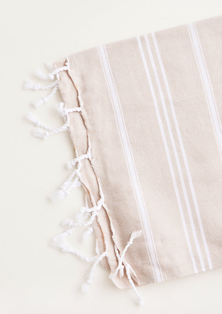 Tan / Hand Towel: Cotton towel with white stripes in tan, twisted fringe on ends