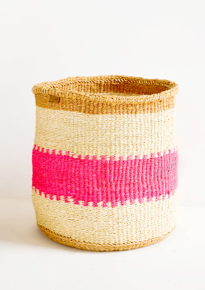 Large: Woven sisal basket in tan stripes with neon pink middle stripe