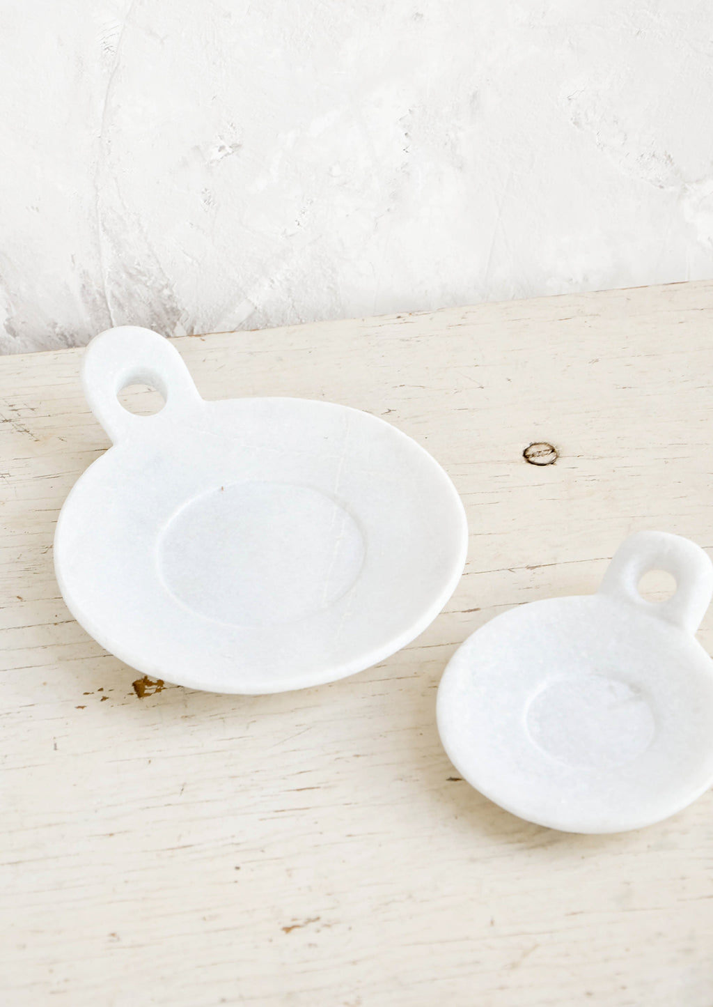 1: Round marble dishes with circular cutout side handle and circular inset at center