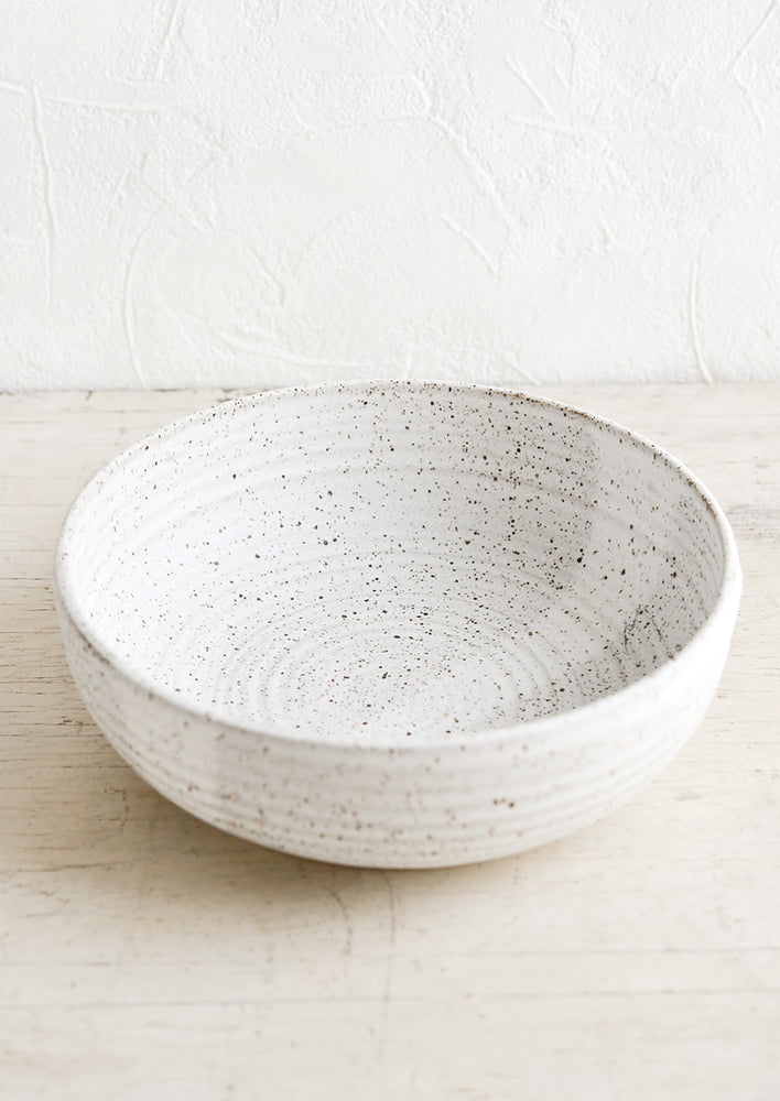 Speckled White: A ceramic serving bowl in matte speckled white.