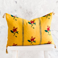 Mustard: Block printed lumbar pillow in mustard yellow fabric with red flowers