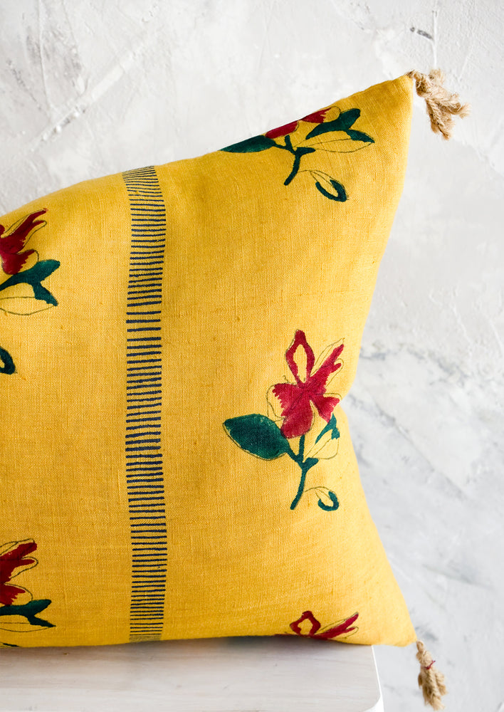 5: Linen pillow in mustard yellow with red and green block printed floral pattern