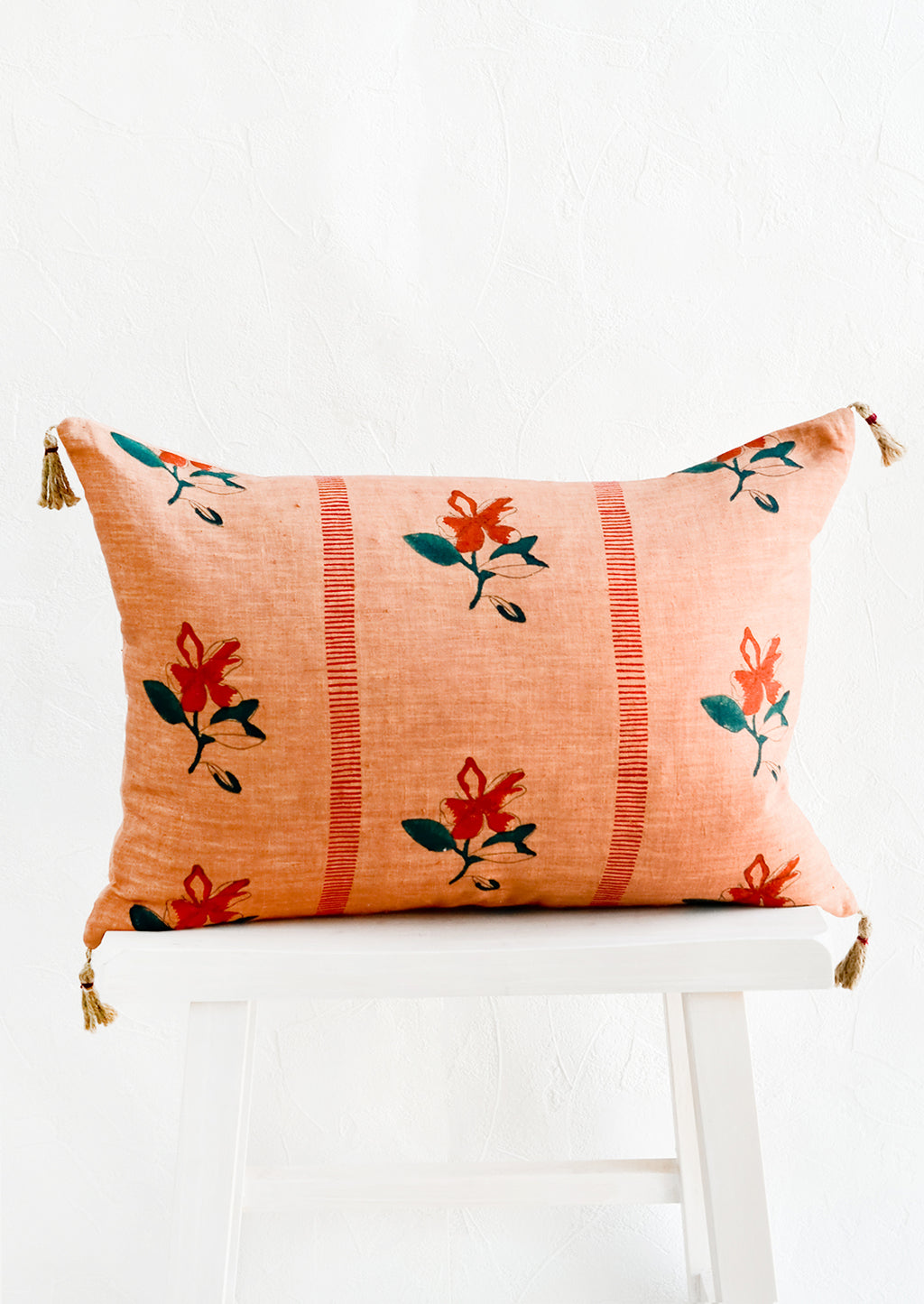 Clay Brown: Block printed lumbar pillow in clay brown fabric with red flowers