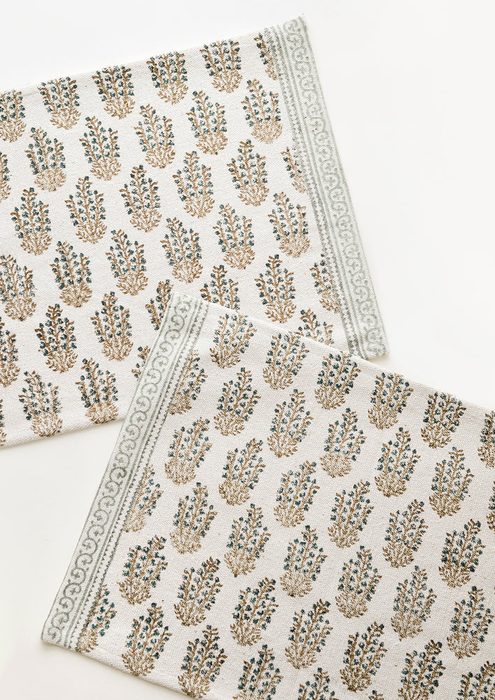 Mint Multi: Two ivory rectangular cotton placemats with green floral pattern.