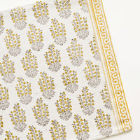 1: An ivory rectangular cotton placemat with yellow floral pattern.