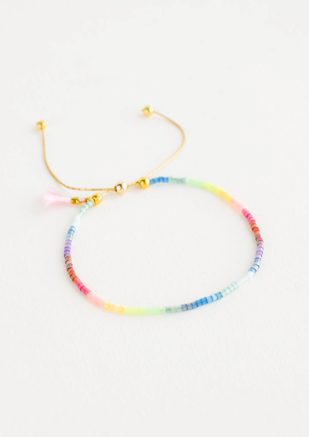 Rainbow Multi: Delicate bracelet of rainbow colored glass beads on a thin gold chain.