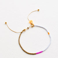 Periwinkle / Olive: Delicate bracelet with sections of glass beads in khaki, metallic pink, light blue, and neon orange on a thin gold chain.