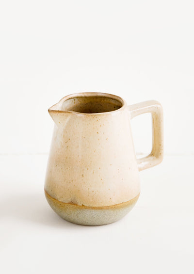Small ceramic pitcher in speckled tan glaze and squared handle