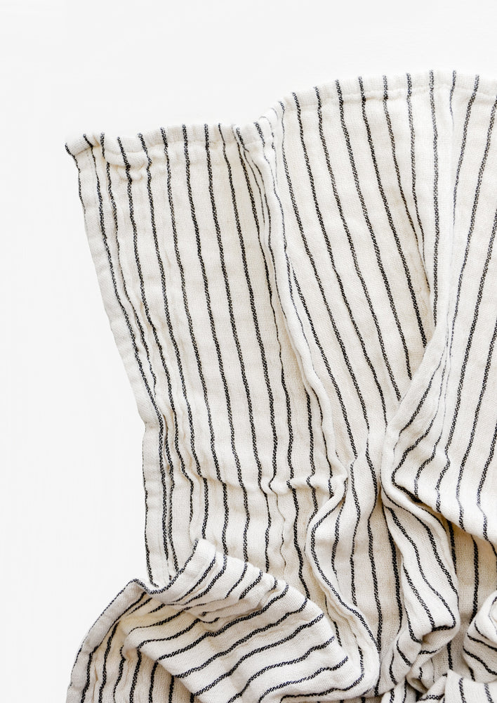 Gauzy cotton tea towel in natural cotton with vertical black stripes
