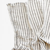 Cream / Black: Gauzy cotton tea towel in natural cotton with vertical black stripes