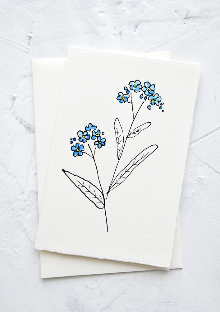 1: A letterpress printed greeting card made from hand-torn paper with hand-painted flower on front.