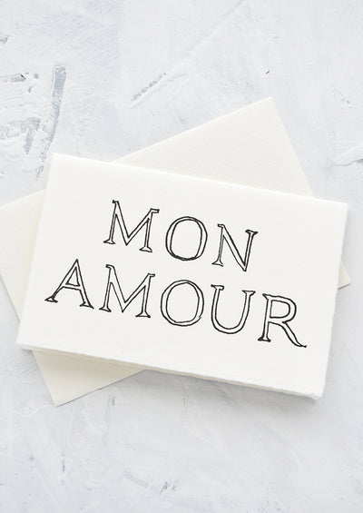 "A letterpress printed greeting card on handmade paper with ""Mon Amour"" printed on front."