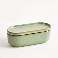 1: Oblong oval green Ceramic Container with Lid.