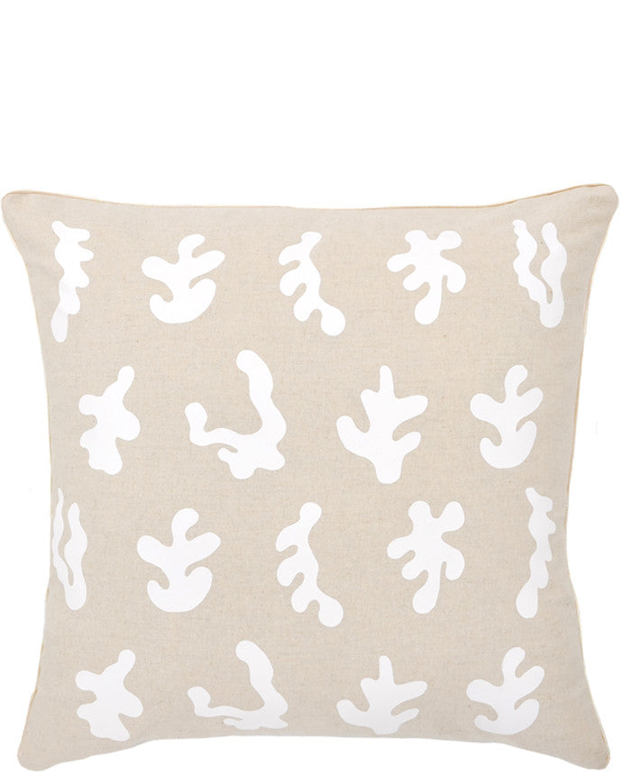 Square throw pillow in natural linen color with white, screen printed seaweed shapes
