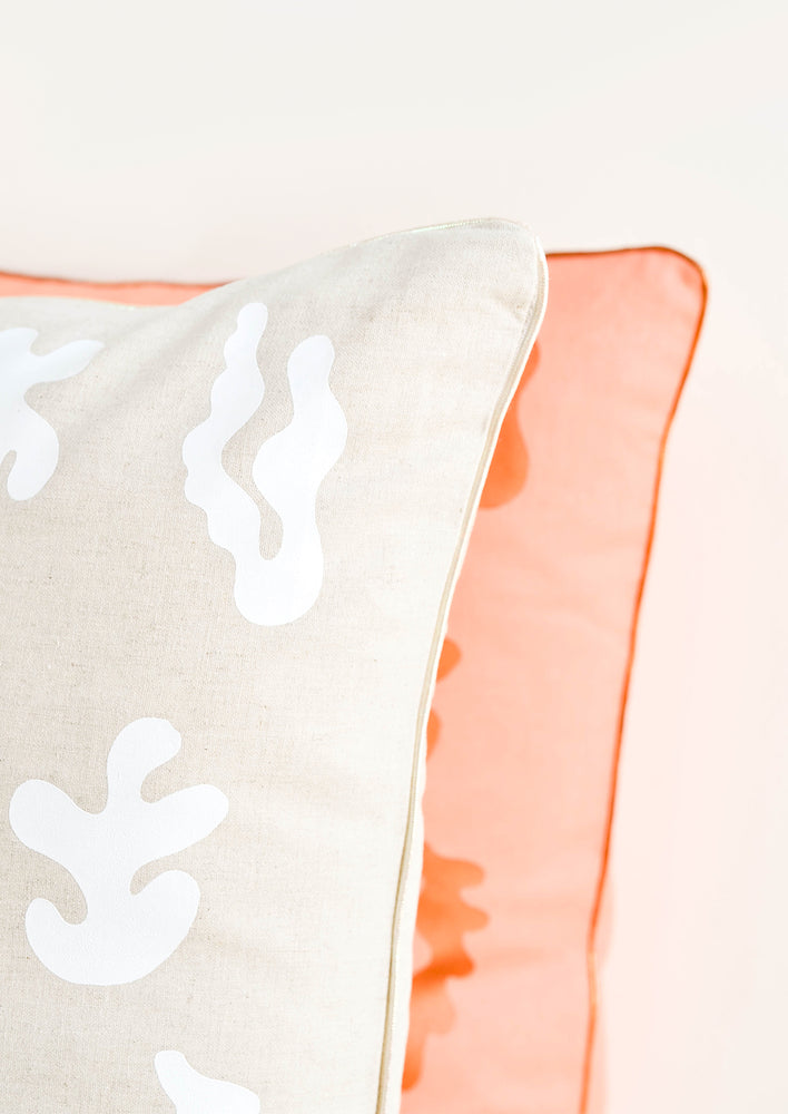 3: Close up of metallic and iridescent trim detail on printed throw pillows