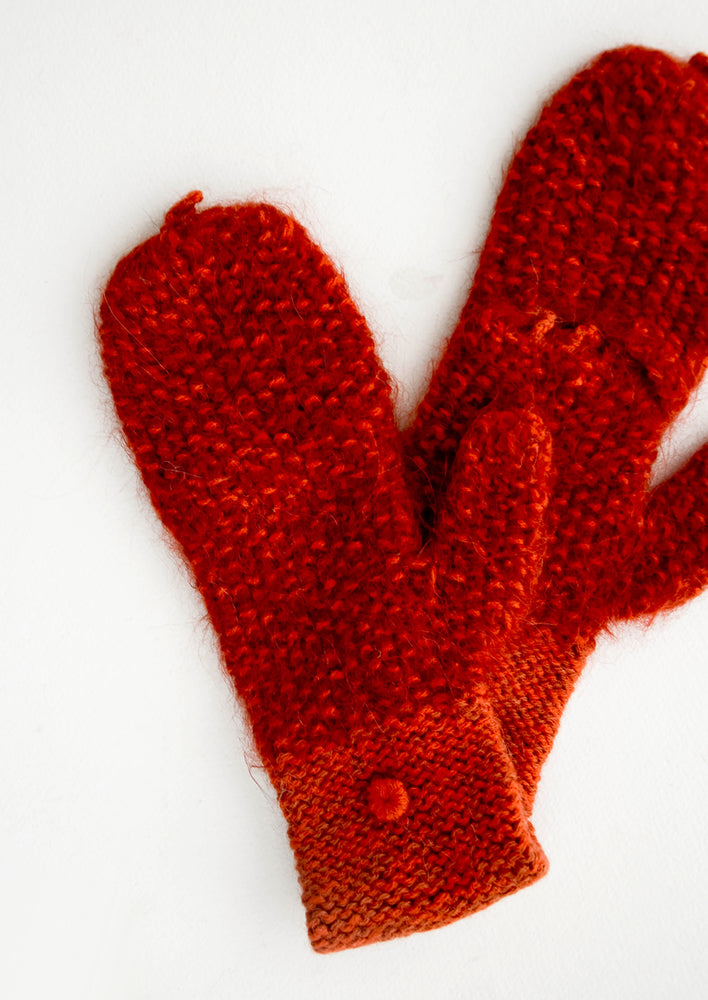 Rust: Deep red alpaca and wool mittens with small loop at top and little button on outer wrist.