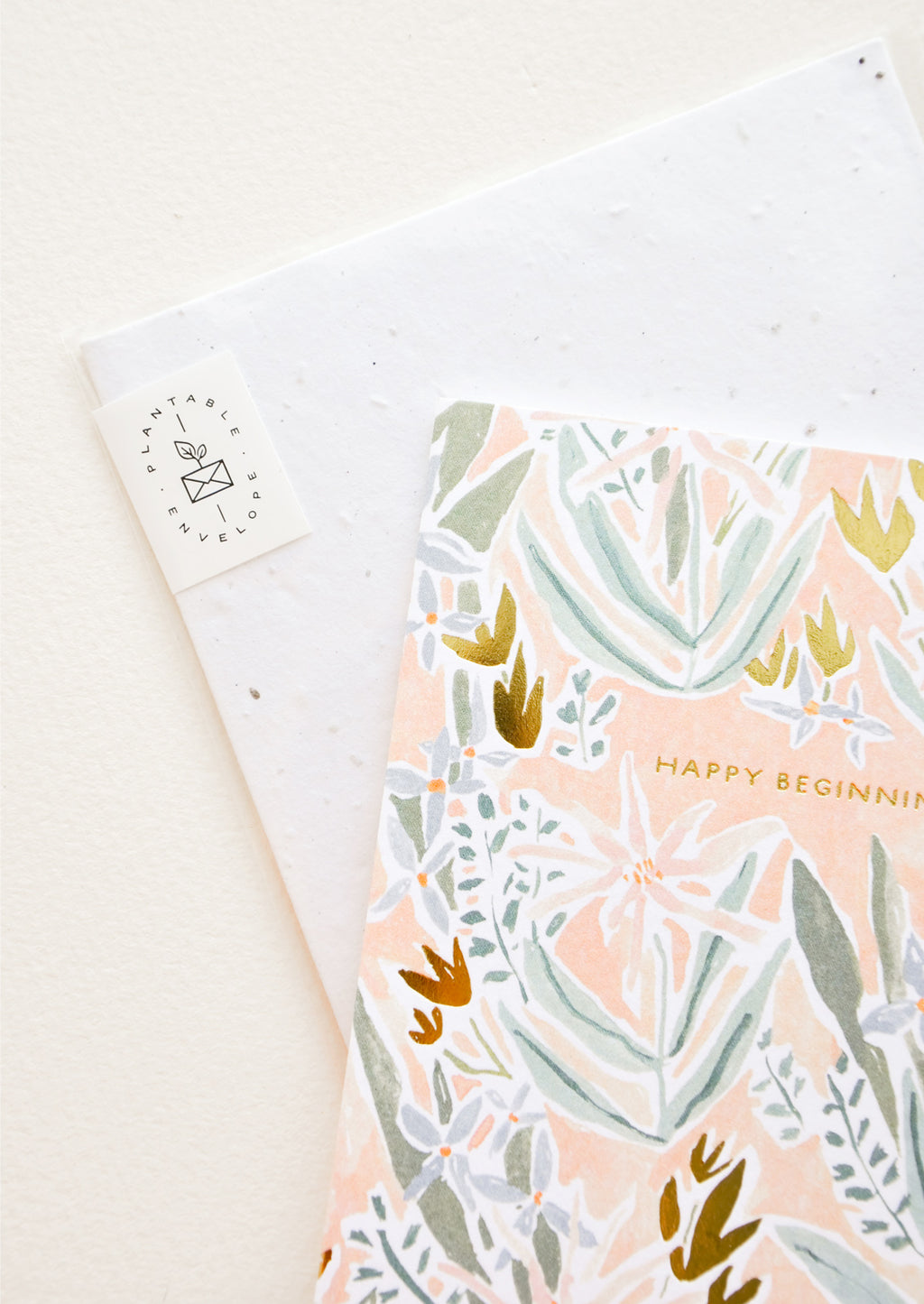 2: Copper text detailing on floral print greeting card