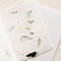 2: The blank inside of a greeting card made from handmade flower petal paper.