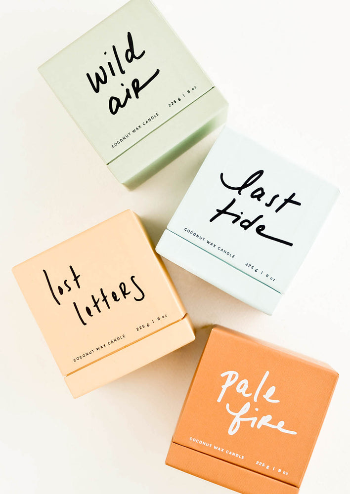 2: Four boxes in light green, pale blue, peach, and rust with cursive text.