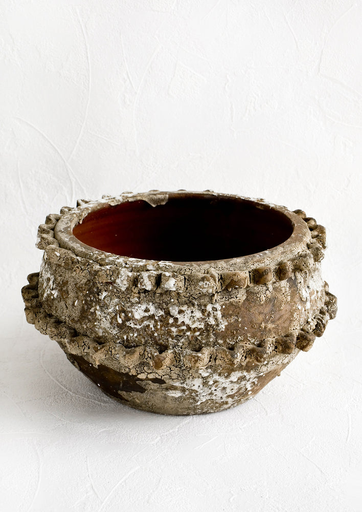 1: Distressed ceramic planter in chippy brown and white glaze with textured applique