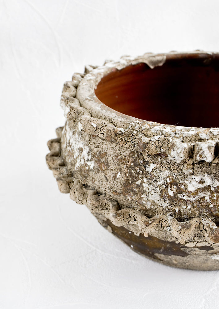 2: Distressed ceramic planter in chippy brown and white glaze with textured applique