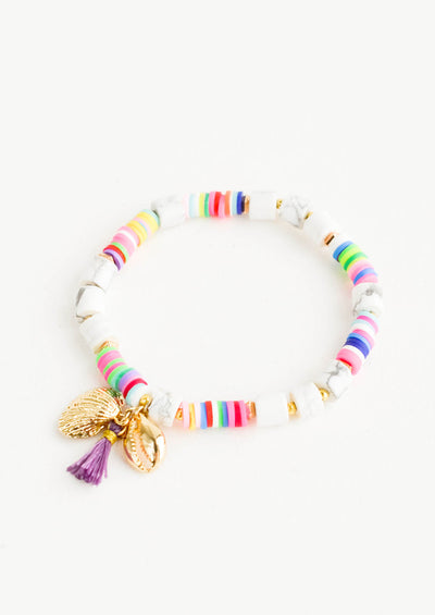 Beaded bracelet with chunky faux marble beads mixed with multicolor heishi beads, two gold shell charms and tassel detail