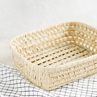 Large: A shallow storage basket made from dried palm leaf.
