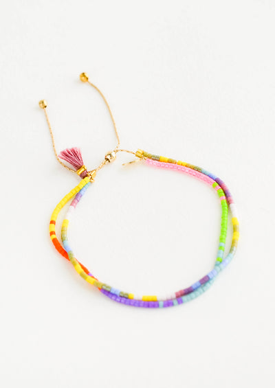 Beaded bracelet made up of two strands, beaded in bright multicolor seed beads with a gold metal closure