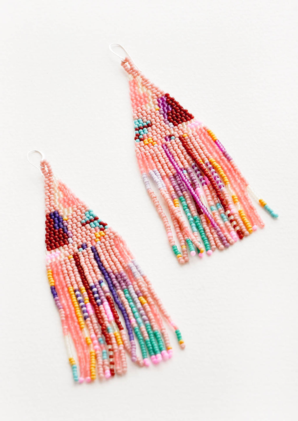 1: Pink fringe beaded earrings with irregular sections of blue, green, purple, maroon, yellow, and orange.