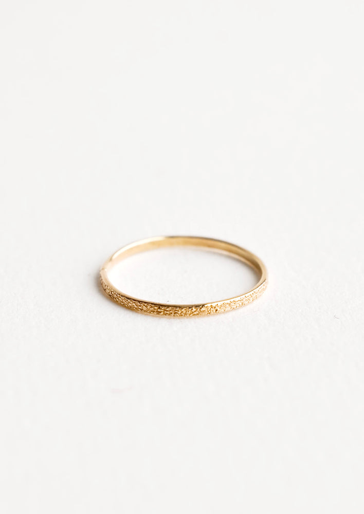 1: Slim yellow gold ring with textured surface.