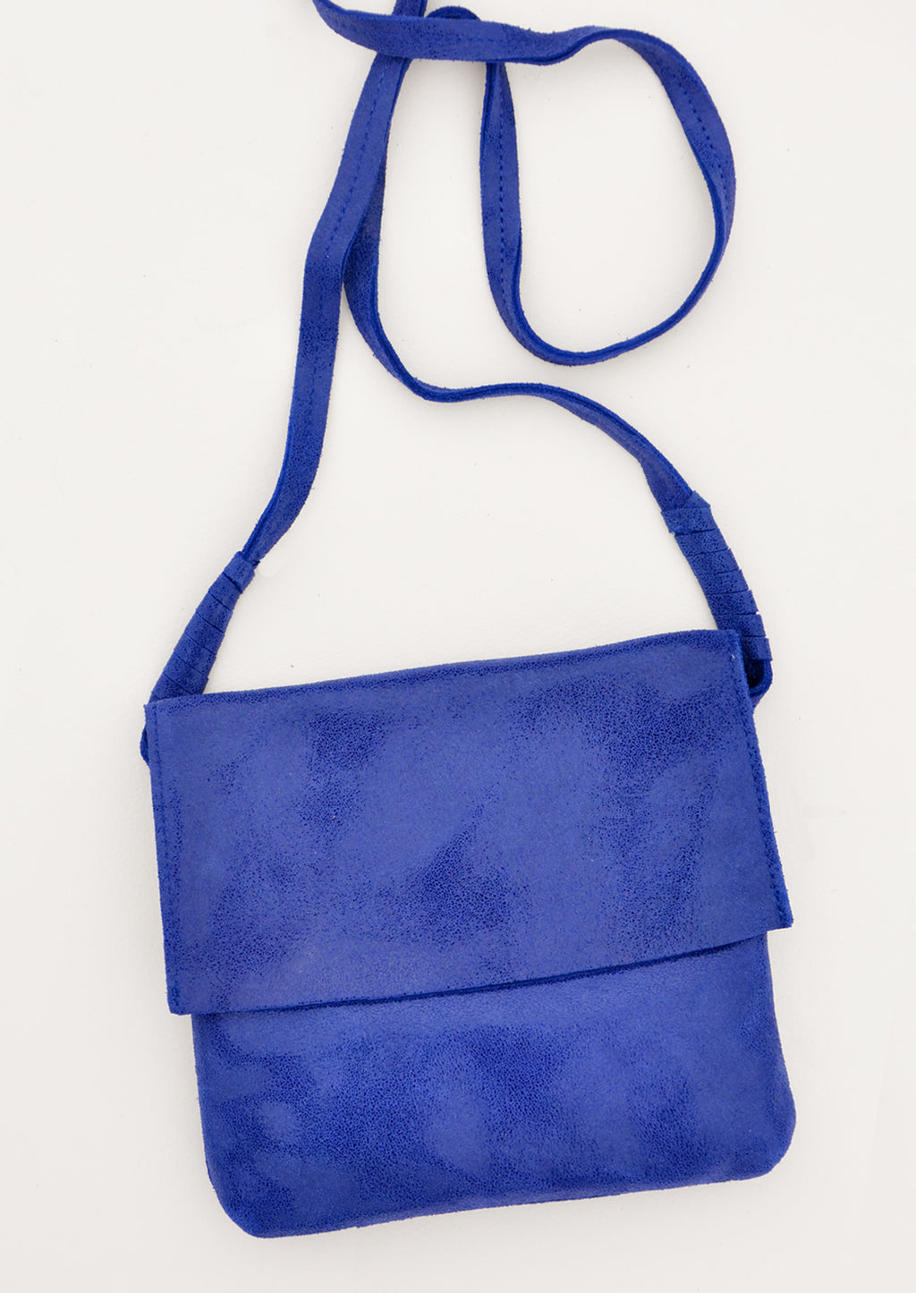 Sapphire: Bright blue soft leather bag with flap closure, cross body strap, and metallic sheen.