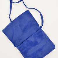 5: Bright blue cross body leather bag shown with flap upturned.