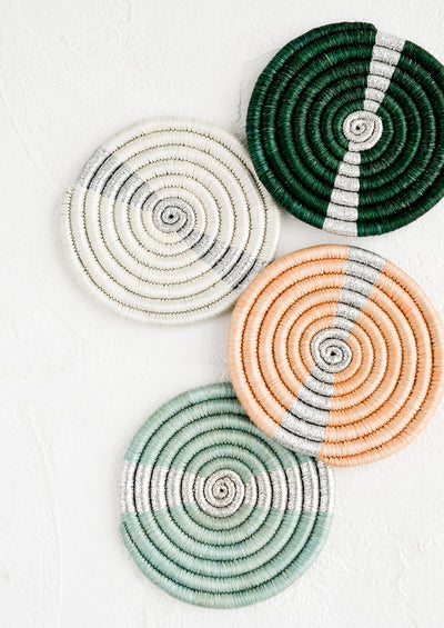 A set of coasters in different colors with silver streak across middle.
