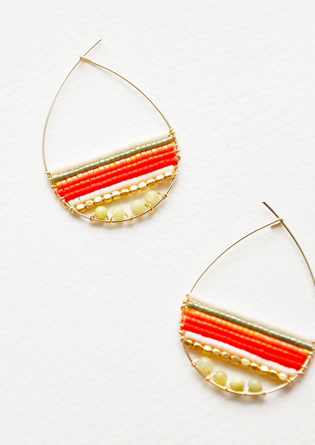 Olive / Orange Multi: Teardrop shaped hoop earrings in yellow gold with multicolored yellow and red beaded bars across.