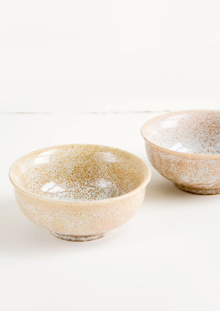 1: Small ceramic bowls with footed silhouette in reactive brown glaze