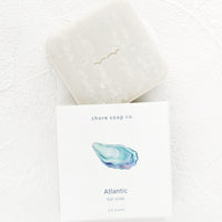 Atlantic: Square bar soap emerging from nautical themed packaging