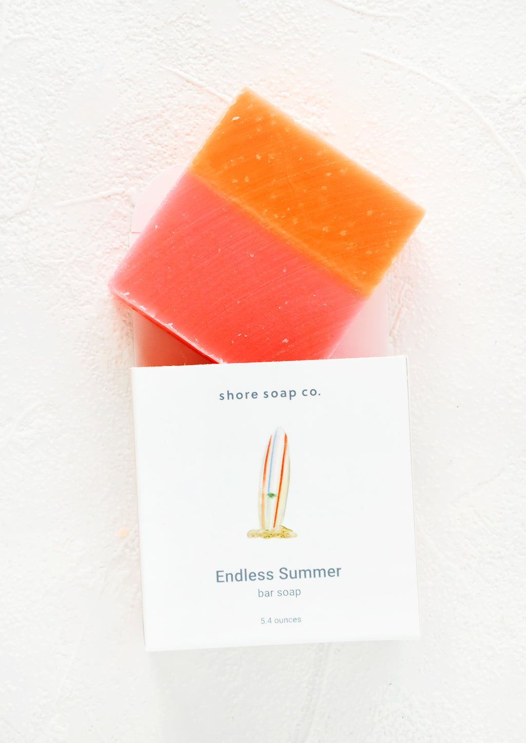 Endless Summer: Square bar soap in pink & orange emerging from nautical themed packaging