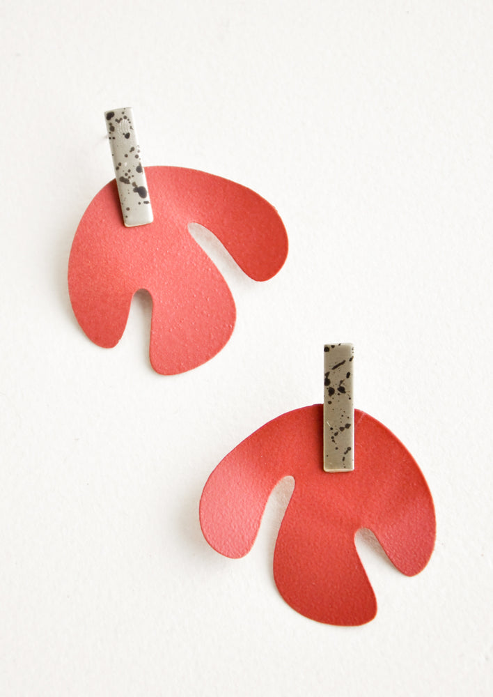 Sienna / Silver Spot: Post earrings with red asymmetric leaf shape hanging from small speckled rectangle.
