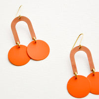 Dark Peach / Orange: Orange earrings form a curved arc with two discs at each end.