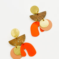 1: Earrings with layered circles and abstract shapes of gold, nude, bright orange and patina brass.